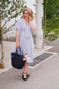 vintage flair, vintage, retro polka dots, retro dress, polka dot dress, black and white, straw bag, black platform sandals, cute look, summer date night idea, peonies, pearl heandband