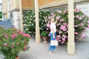 denim, casual outfit, oleander bushes, pink flowers, graphic tee, style blogger, fashion, summerstyle, summer 19, modern combo, guess handbag, Madame Schischi